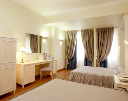 quadruple room, ideal for four people. It's a Family room perfect for a pleasant stay in Rome. The dreaming offers guests free wi-fi and cable TV, sky tv and minibar drinks. Also ideal as a business room.